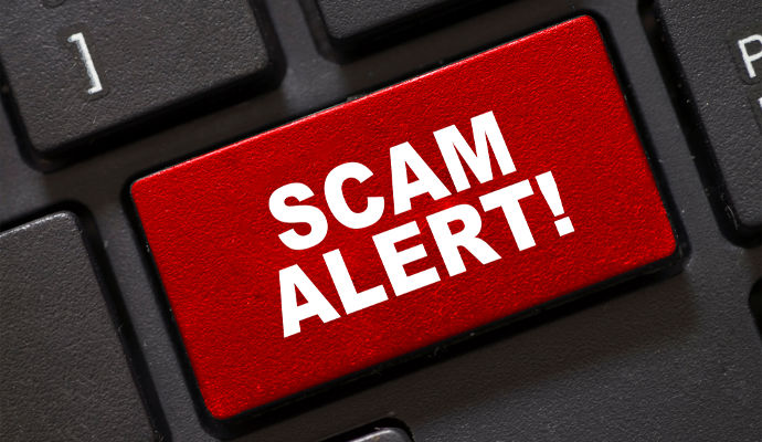 red scam alert button