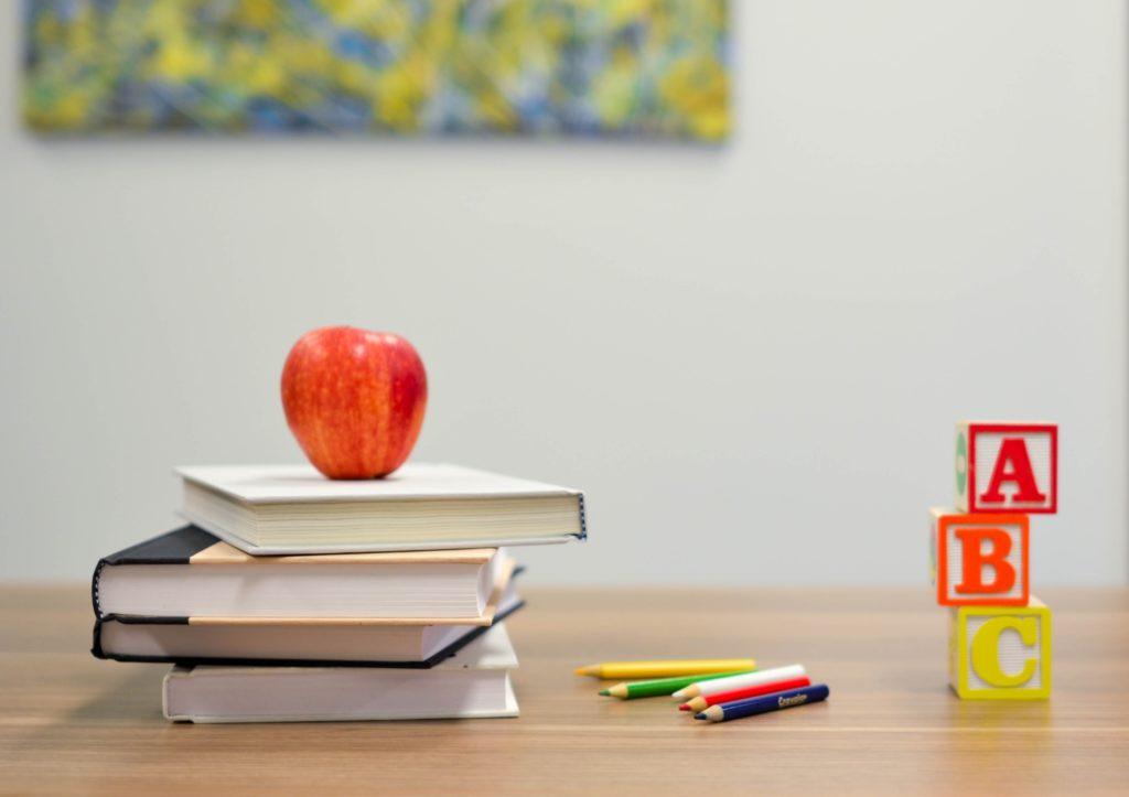 books with apple and alphabet blocks